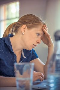 stressed woman | dealing with stress at work | Head Strong Workplaces